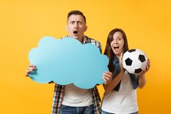 Young cheerful couple, woman man, football fans holding empty blank Say cloud, speech bubble, cheer up support team. Young cheerful couple, women man, football royalty free stock images