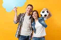 Young cheerful couple, woman man, football fans holding empty blank Say cloud, speech bubble, cheer up support team. Young cheerful couple, women man, football stock image