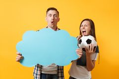 Young cheerful couple, woman man, football fans holding empty blank Say cloud, speech bubble, cheer up support team. Young cheerful couple, women man, football royalty free stock image