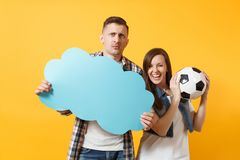 Young cheerful couple, woman man, football fans holding empty blank Say cloud, speech bubble, cheer up support team. Young cheerful couple, women man, football stock images