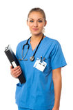 Young cheerful female doctor. Charming young doctor holding patient records Royalty Free Stock Photos