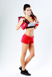 Young cheerful fitness woman standing with boxing gloves Stock Photography
