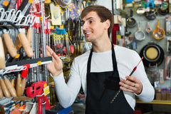 Young cheerful friendly salesman working and smiling Stock Photo