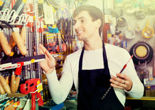 Young cheerful friendly salesman working and smiling Stock Photography