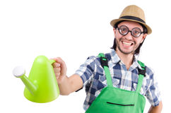 Young cheerful gardener with watering can isolated Royalty Free Stock Images