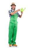 The young cheerful gardener with watering can Stock Photos