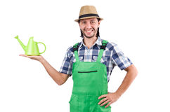 The young cheerful gardener with watering can Royalty Free Stock Photography