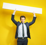 Young cheerful gentleman with board Stock Image