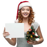Young cheerful girl holding sign on white Royalty Free Stock Photography