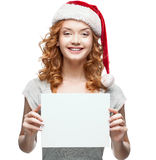 Young cheerful girl holding sign on white Royalty Free Stock Images