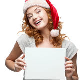 Young cheerful girl holding sign on white Stock Photo