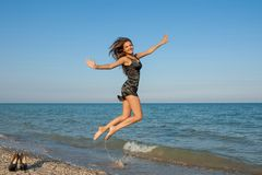 Young cheerful girl on the sea Royalty Free Stock Image