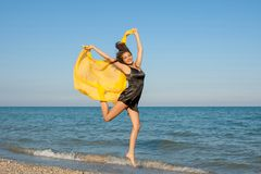 Young cheerful girl on the sea Royalty Free Stock Photos
