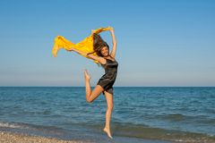 Young cheerful girl on the sea Royalty Free Stock Photo
