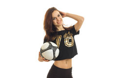 Young cheerful girl in a shirt holding a soccer ball and smiling Royalty Free Stock Image