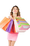 Young cheerful girl with shopping bags isolated on white Stock Photo