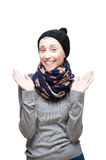 Young cheerful girl in winter clothing on white Stock Image