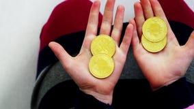 Close-up girl counts golden bitcoin. Young ,cheerful ,happy girl counts golden bitcoin stock footage