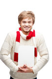 Young cheerful happy man holding sign. Portrait of young cheerful happy caucasian man which holding sign with nice smile Royalty Free Stock Image