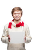 Young cheerful happy man holding sign. Portrait of young cheerful happy caucasian man which holding sign with nice smile Stock Photo