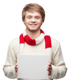 Young cheerful happy man holding sign Stock Images