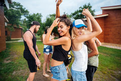 Young cheerful happy teens dancing at the picnic area Stock Image