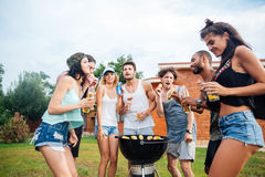 Young cheerful happy teens dancing at the picnic area Royalty Free Stock Photos