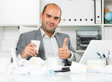 Young cheerful male worker having glad royalty free stock image