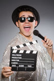 Young cheerful man with clapperboard and Stock Photos