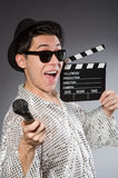 Young cheerful man with clapperboard and Stock Photo