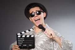 Young cheerful man with clapperboard and Stock Image