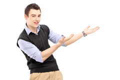 Young cheerful man gesturing Stock Photo