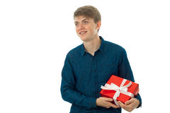 Young cheerful man with gift in his hands Stock Photography