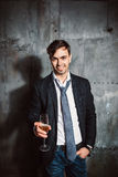 Young cheerful man relaxing at party Stock Photo
