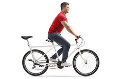Young cheerful man riding a tandem bicycle alone. Full length shot of a young cheerful man riding a tandem bicycle alone isolated on white background stock images