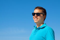 Young cheerful man in sunglasses Stock Photo