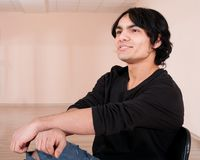 Young cheerful man in training hall Stock Photography