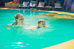 Young cheerful mother and son in a swimming pool Stock Image