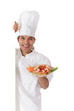 Young cheerful nepalese chef male, plate Royalty Free Stock Photo