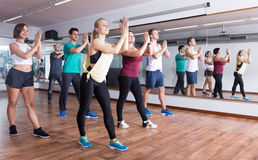 Young cheerful people dancing zumba elements. In dancing class Royalty Free Stock Images