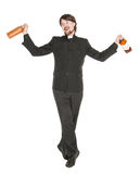 Young cheerful priest with bottle of alcohol isolated Stock Photo