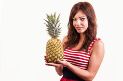 Young cheerful smiling healthy and joyful woman with big pineapple Stock Photo