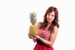 Young cheerful smiling healthy and joyful woman with big pineapple. Young cheerful, smiling healthy and joyful woman with big pineapple Royalty Free Stock Photography