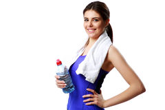 Young cheerful sport woman holding bottle with water Stock Images