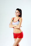 Young cheerful sport woman standing with arms folded Royalty Free Stock Images
