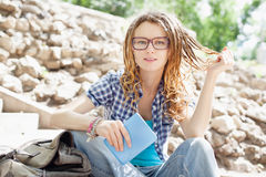 Young cheerful stylish girl with dreadlocks. Stock Images