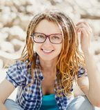 Young cheerful stylish girl with dreadlocks Stock Images