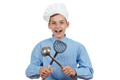 Young cheerful teenager with ladle and humor in a chef's hat. Isolated studio Stock Photography