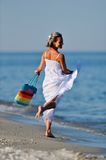 Young cheerful woman on the beach Stock Photo