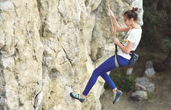 Woman rock climber on the cliff Royalty Free Stock Images